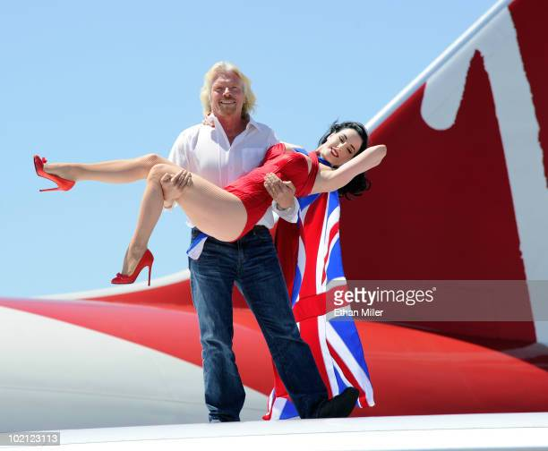 Founder and President of Virgin Group Sir Richard Branson holds burlesque artist Dita Von Teese as they appear on the wing of a Virgin Atlantic...