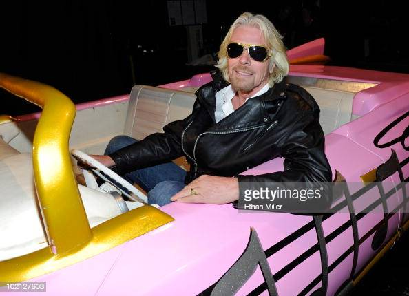 Founder and President of Virgin Group Sir Richard Branson poses in a prop pink Cadillac at 'Viva ELVIS' by Cirque du Soleil at the Aria Resort Casino...