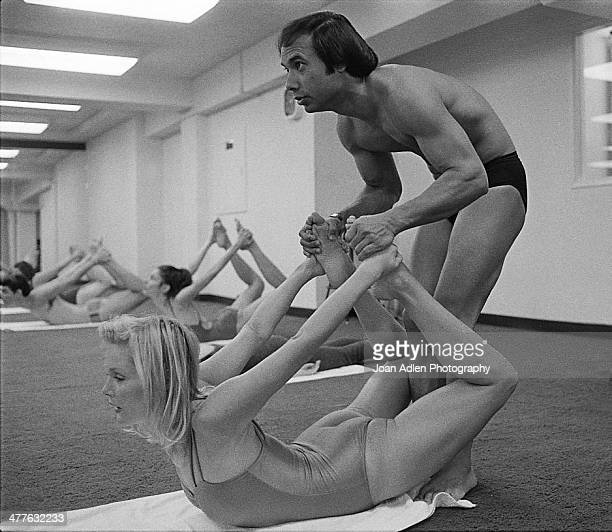 Founder and teacher of Bikram Yoga Bikram Choudhury assists actress Carol Lynley with the 'Bow Pose' at his yoga studio in Beverly Hills California