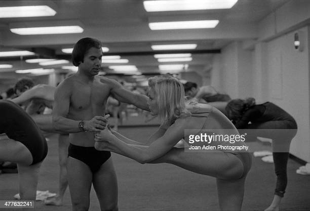 Founder and teacher of Bikram Yoga Bikram Choudhury assists actress Carol Lynley with the 'Standing Head to Knee Pose' at his yoga studio in Beverly...