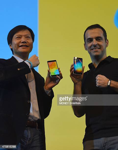 Founder Chairman and CEO of Xiaomi Global Lei Jin and Vice President Hugo Barra gesture during the launch of Xiaomi's Mi4i smart phone in New Delhi...