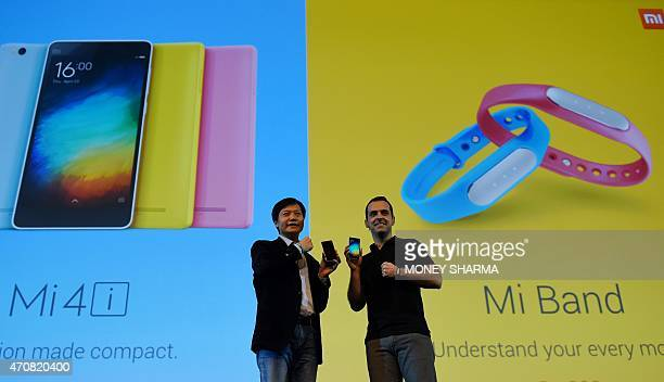 Founder Chairman and CEO of Xiaomi Global Lei Jin and Vice President Hugo Barra gesture during the launch of Xiaomi's Mi4i smart phone and Mi Band in...