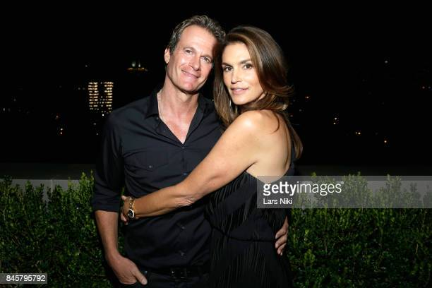 Founder Gerber Group Rande Gerber and model Cindy Crawford attends the fashion week celebration with DuJour Magazine hosted by Cindy Crawford and...