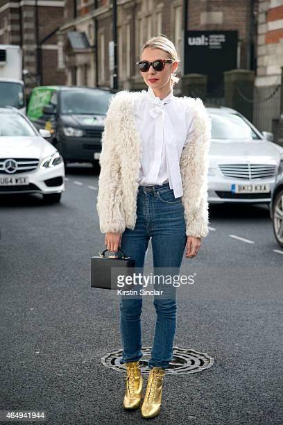 Founder of Avenue 32 Roberta Banteler wears Saint Laurent boots a Mark Cross bag Isabel Marant jacket Celine sunglasses Yves saint Laurent shirt and...