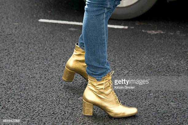Founder of Avenue 32 Roberta Banteler wears Saint Laurent boots and Saint Laurent jeans on February 24 2015 in London England