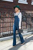 Founder of Avenue 32 Roberta Benteler wears Frame denim dungerees Marc Cross bag Petit Bateau top on February 23 2015 in London England