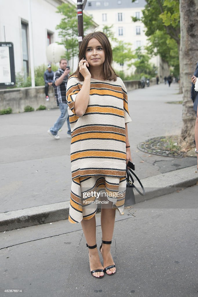 Founder of Buro 24/7 <a gi-track='captionPersonalityLinkClicked' href=/galleries/search?phrase=Miroslava+Duma&family=editorial&specificpeople=7039024 ng-click='$event.stopPropagation()'>Miroslava Duma</a> wearing a Chloe dress, Manolo Blahnik shoes and an Hermes bag day 5 of Paris Haute Couture Fashion Week Autumn/Winter 2014, on July 10, 2014 in Paris, France.