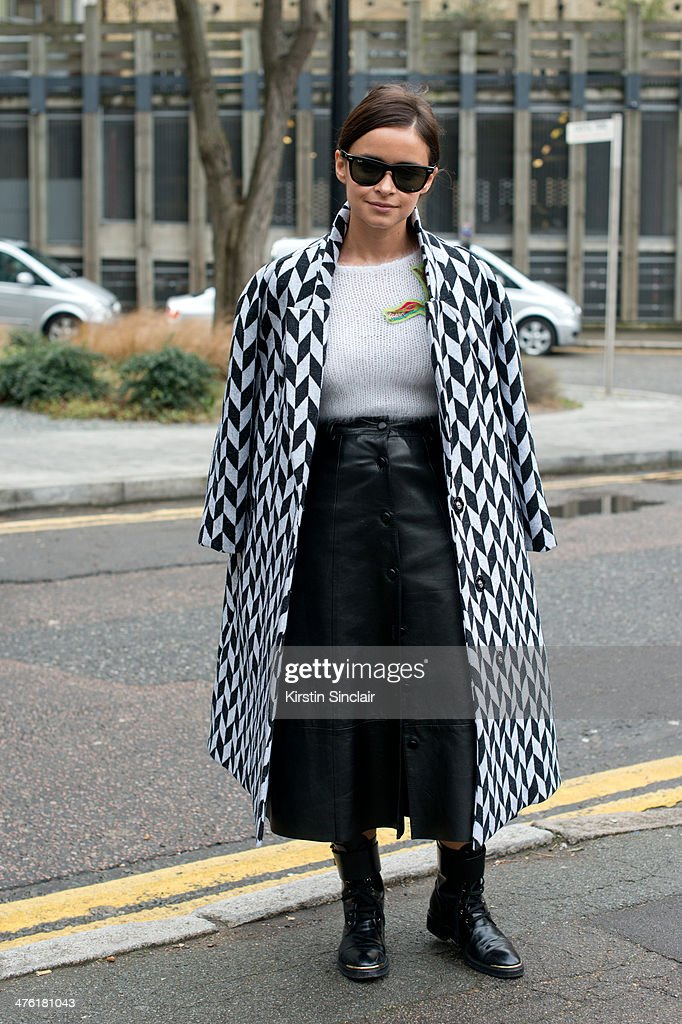 Founder of Buro247 <a gi-track='captionPersonalityLinkClicked' href=/galleries/search?phrase=Miroslava+Duma&family=editorial&specificpeople=7039024 ng-click='$event.stopPropagation()'>Miroslava Duma</a> wears a Vika Gazinskaya coat and Natasha Zinko top and skirt, Louis Vuitton boots and Ray Ban sunglasses on day 5 of London Collections: Women on February 18, 2014 in London, England.