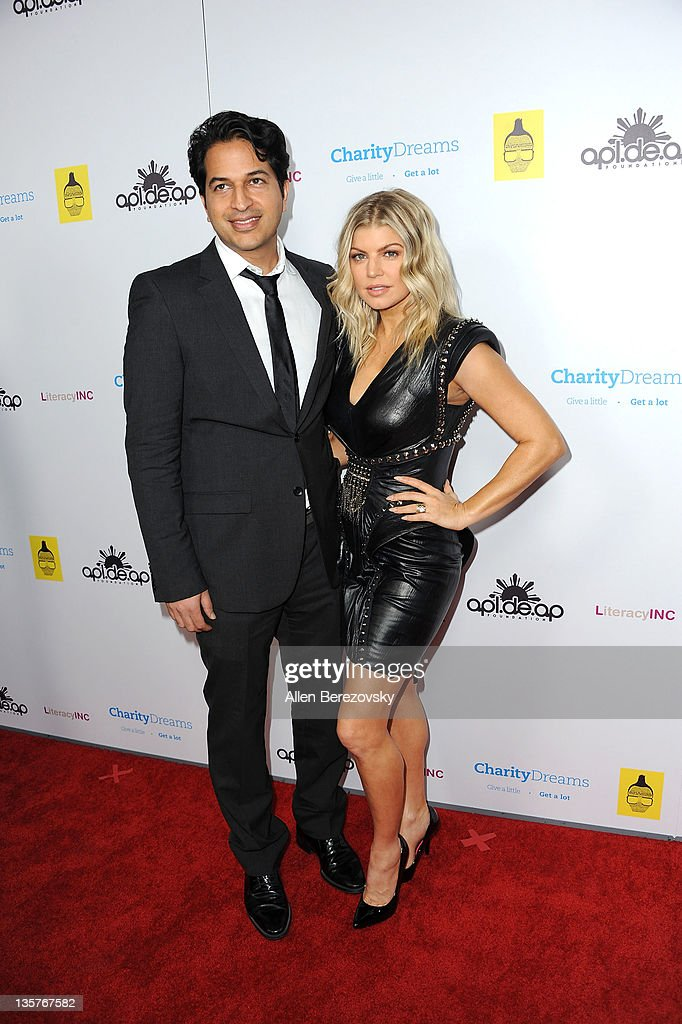Founder of Charity Dreams Omar Amanat and Fergie of The Black Eyed Peas' arrive at apl.de.ap's of The Black Eyed Peas' birthday celebration at The Conga Room at L.A. Live on December 13, 2011 in Los Angeles, California.