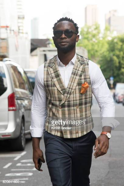 Founder of cutsforhimcom Edmund Kamara wears a Suit Supply waistcoat and trousers Hudsons of London pocket square Tom Ford sunglasses and a Timex...