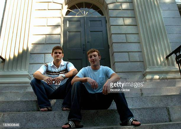 Founder of Facebookcom Mark Zuckerberg right and Dustin Moscovitz cofounder left have their photo taken at Harvard Yard The two are students at...