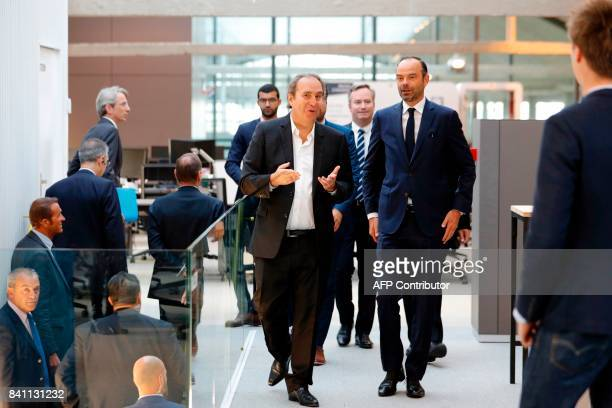 Founder of French broadband Internet provider Iliad Xavier Niel and French Prime Minister Edouard Philippe visit the startup incubator 'Station F' in...