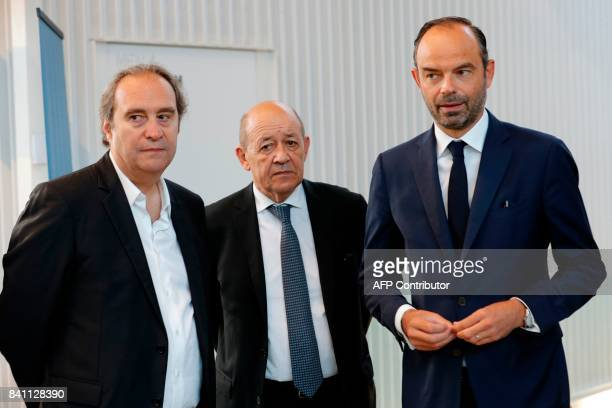 Founder of French broadband Internet provider Iliad Xavier Niel French Foreign Affairs Minister JeanYves Le Drian and French Prime Minister Edouard...