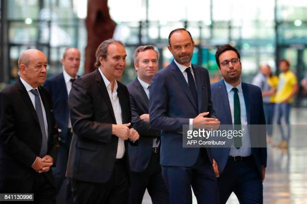 Founder of French broadband Internet provider Iliad Xavier Niel French Prime Minister Edouard Philippe French Foreign Affairs Minister JeanYves Le...