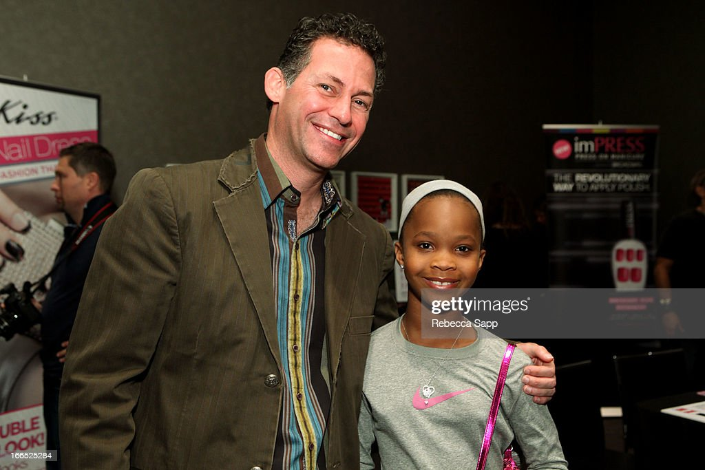 Founder of GBK Productions Gavin Keilly and actress Quvenzhane Wallis at GBK Gift Lounge In Honor Of The MTV Movie Award Nominees And Presenters - Day 2 at W Hollywood on April 13, 2013 in Hollywood, California.