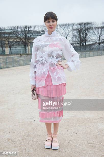 Founder of Geomodels Tako Chkheidze wears an Atelier Kikala jacket and skirt and Valentino bag on day 8 of Paris Collections Women on March 10 2015...