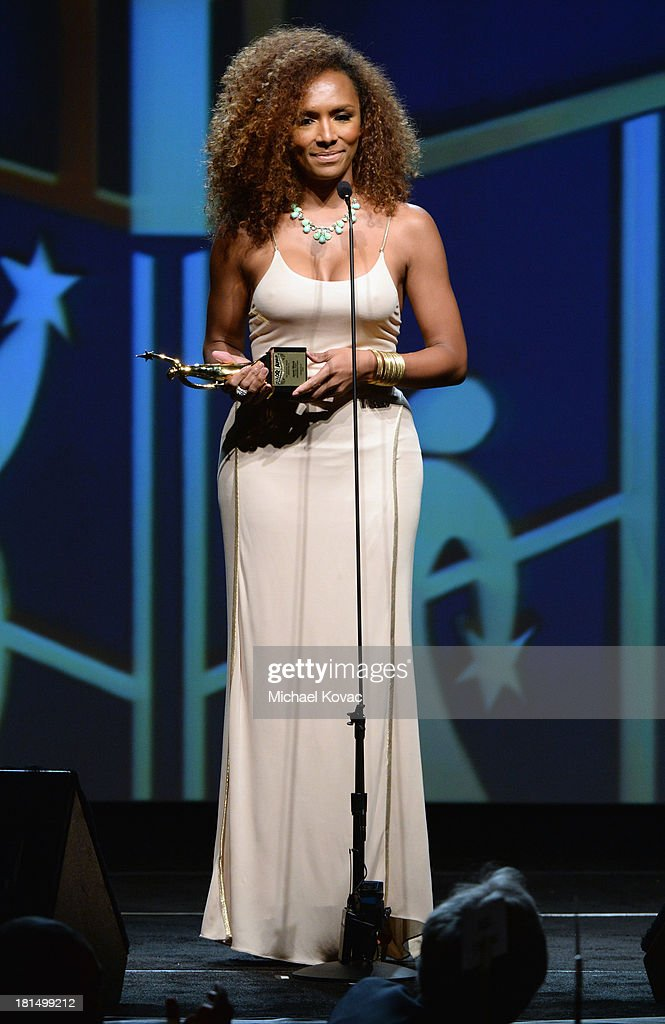 Founder of #GIRLSLIKEUS Janet Mock speaks on stage at the ADCOLOR Awards at The Beverly Hilton Hotel on September 21, 2013 in Beverly Hills, California.