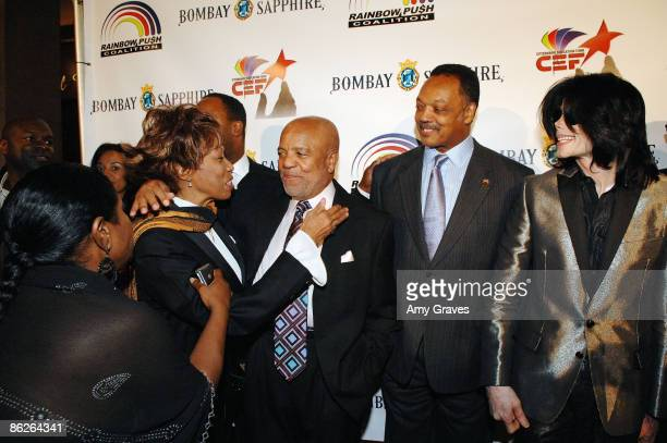 Founder of Motown Records Berry Gordy Founder and President of the Rainbow PUSH Coalition Reverend Jesse Jackson Sr Singer Michael Jackson greet wife...