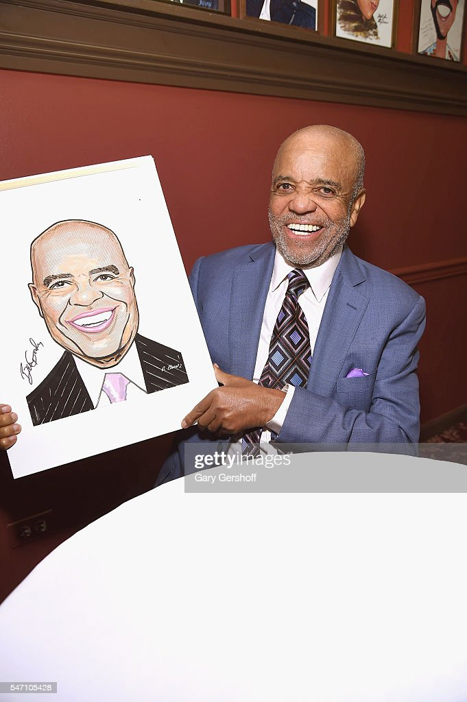 Founder of Motown Records, Berry Gordy poses with his portrait at Sardi's on July 13, 2016 in New York City.