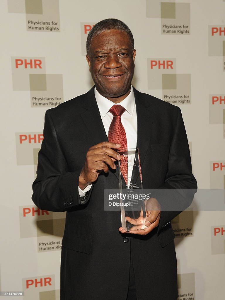 Founder of Panzi Hospital, Dr. <a gi-track='captionPersonalityLinkClicked' href=/galleries/search?phrase=Denis+Mukwege&family=editorial&specificpeople=5127888 ng-click='$event.stopPropagation()'>Denis Mukwege</a> is posing with his award for fearless advocacy to end the terror of rape in conflict and his devotion to caring for survivors in the Democratic Republic of the Congo as he attends the 2015 Physicians For Human Rights Gala at Jazz at Lincoln Center's Frederick P. Rose Hall on April 28, 2015 in New York City.