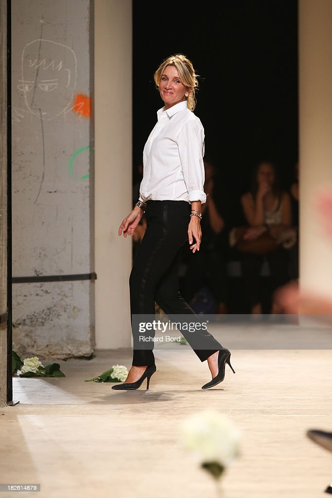 Founder of Paul & Joe Sophie Albou walks the runway after the Paul & Joe show as part of the Paris Fashion Week Womenswear Spring/Summer 2014 on October 1, 2013 in Paris, France.