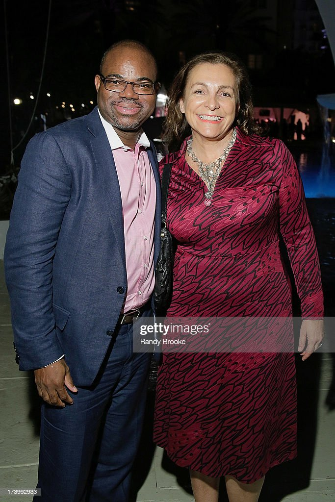 Founder of Reel Code Media Isaac Daniel with friend Sylvia at Mercedes-Benz Fashion Week Swim 2014 - Kick Off Party at Raleigh Hotel on July 18, 2013 in Miami Beach, Florida.