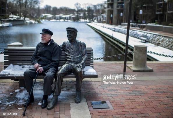 Founder of Reston Robert Simon soon to be 100 years old sits with statue nicknamed Bronze Bob at Lake Anne in Reston Virginia Wednesday March 26 2014...