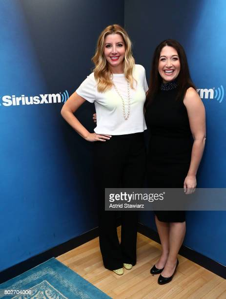 Founder of SPANX Sara Blakey and SiriusXM host Randi Zuckerberg pose for photos during 'SiriusXM's Town Hall With Sara Blakey Hosted By Randi...