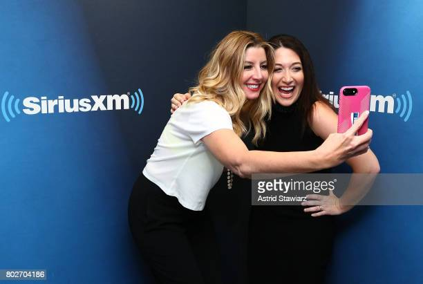 Founder of SPANX Sara Blakey and SiriusXM host Randi Zuckerberg pose for selfies during 'SiriusXM's Town Hall With Sara Blakey Hosted By Randi...