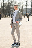Founder of System magazine Elizabeth Von Guttman wears a Paco Rabanne suit and bag and Vanessa Bruno sneakers on day 3 of Paris Collections Women on...