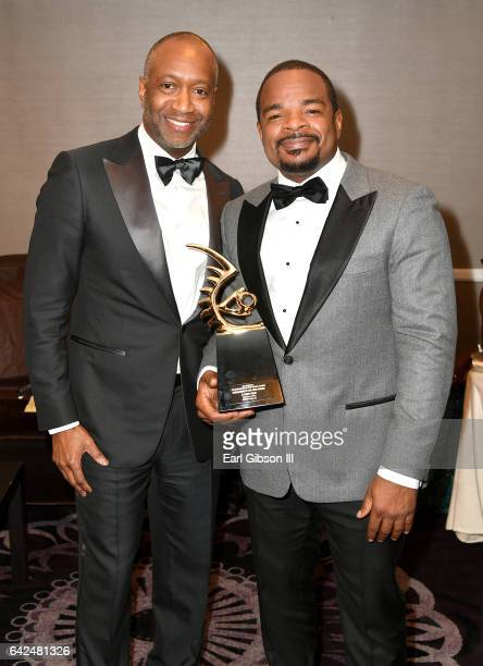 Founder of the ABFF Jeff Friday and honoree F Gary Gray pose with the Excellence in the Arts Award during BET Presents the American Black Film...