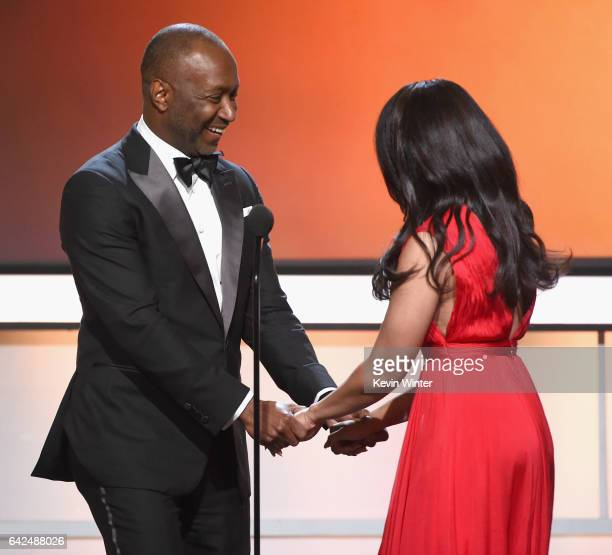 Founder of the ABFF Jeff Friday and Host Regina Hall speak onstage during BET Presents the American Black Film Festival Honors on February 17 2017 in...