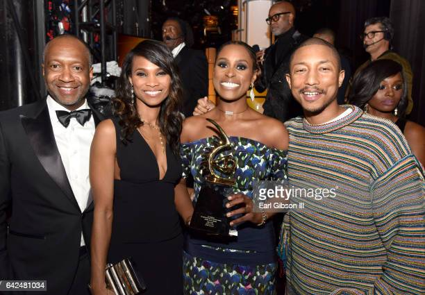 Founder of the ABFF Jeff Friday Nicole Friday honoree Issa Rae and Pharrell Williams pose with the Rising Star Award during BET Presents the American...
