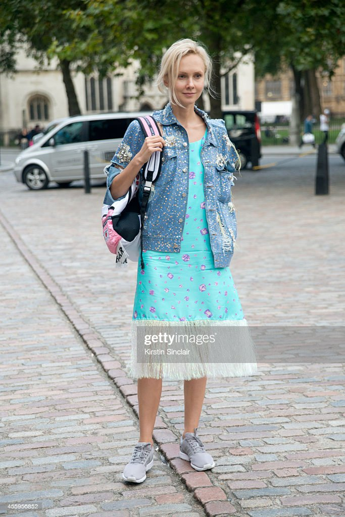 Founder of the concept store and cafe 'Kuznetskiy Most 20' Olga Karput wears Ashish jacket Walk of Shame dress Nasir Mazhar backpack Adidas trainers...