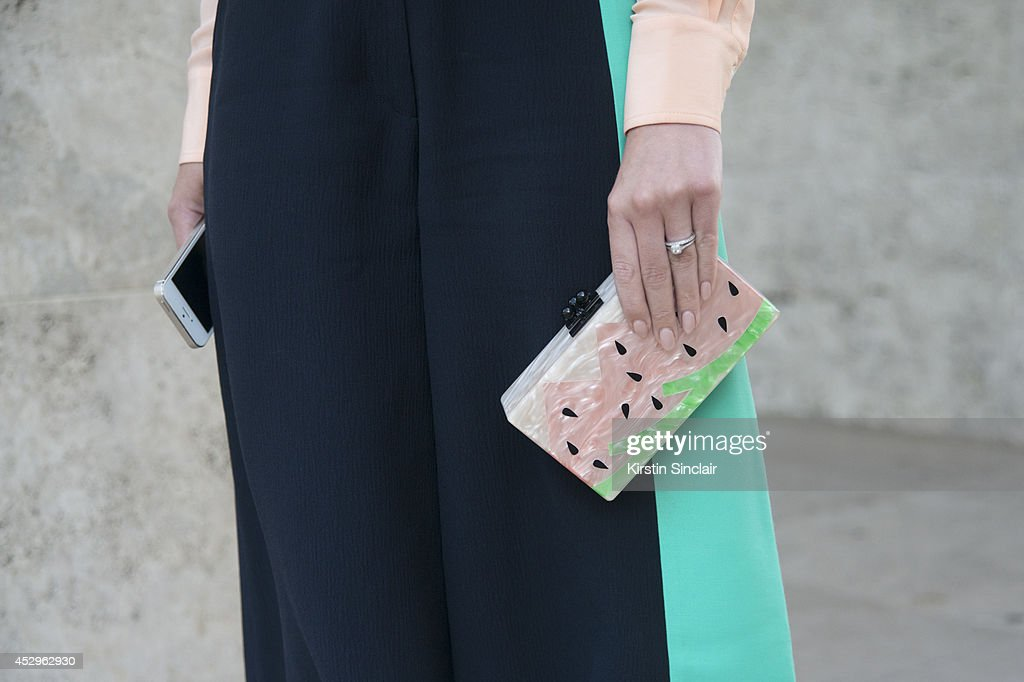 Founder of Threads Styling Sophie Hill wearing a Levi's shirt, Roksanda Ilincic trousers and an Edie Parker clutch bag day 3 of Paris Haute Couture Fashion Week Autumn/Winter 2014, on July 8, 2014 in Paris, France.