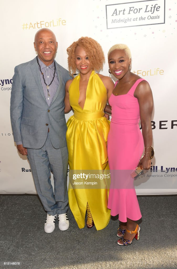 Founder, RUSH Philanthropic Arts Foundation Russell Simmons, Honoree, President of Consumer Beauty Division, Coty Esi Eggleston Bracey and Performer Cynthia Erivo attend 'Midnight At The Oasis' Annual Art For Life Benefit hosted by Russell Simmons' Rush Philanthropic Arts Foundation at Fairview Farms on July 15, 2017 in Water Mill, New York.