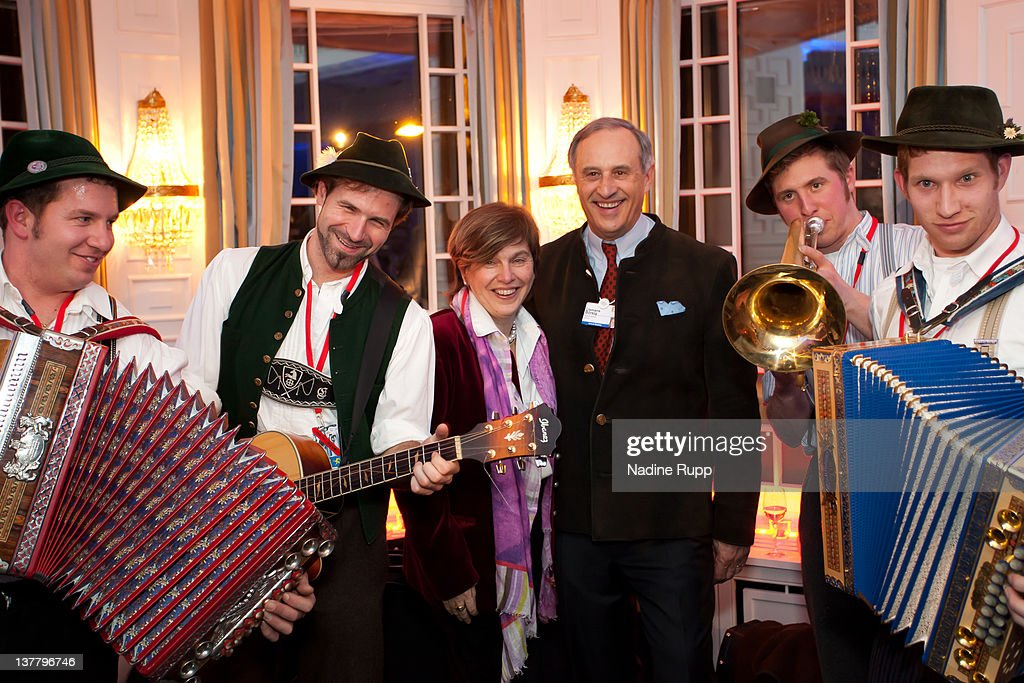 DLD founder Steffi Czerny and Clemens Boersig, chairman of Deutsche Bank AG pose with bavarian musicians during the Burda DLD Nightcap 2011 at the Steigenberger Bellvedere hotel on January 25, 2012 in Davos, Switzerland. DLD (Digital - Life - Design) is a global conference network on innovation, digital, science and culture which connects business, creative and social leaders, opinion-form science and culture which connects business, creative and social leaders, opinion-formers and investors for crossover conversation and inspiration.