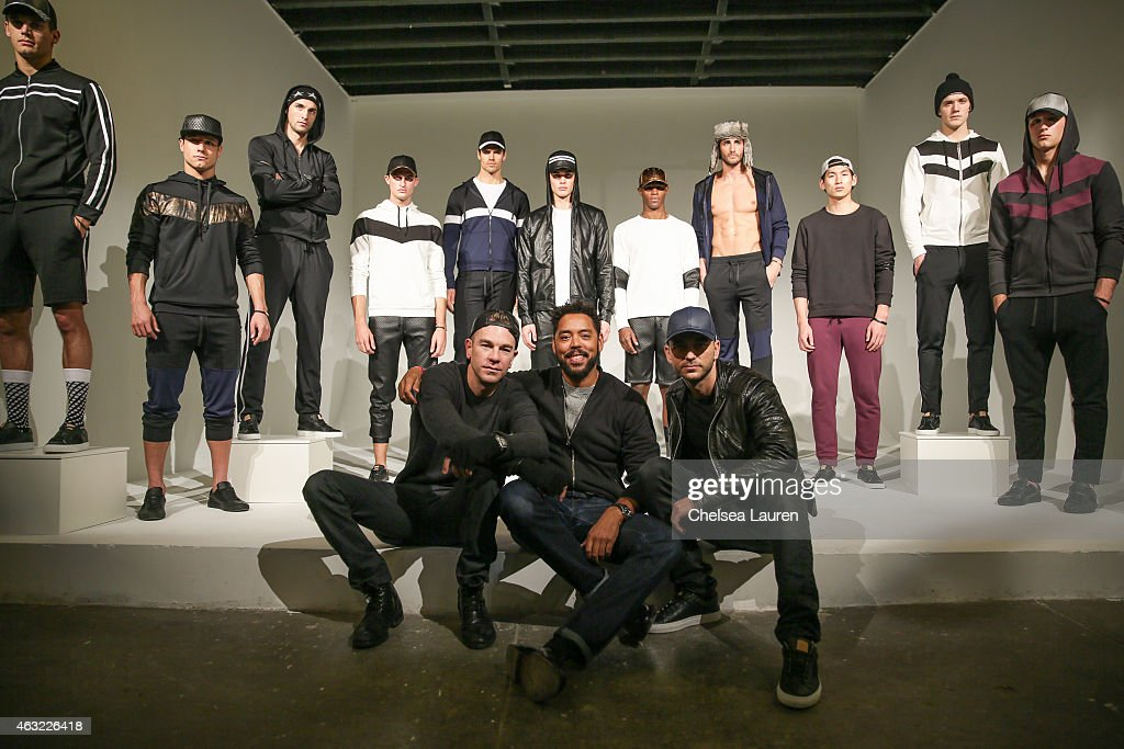 Founder/CEO Josh Reed Esquire senior fashion editor Wendell Brown and designer Trey Alligood pose backstage before the 'Gents' presentation at...