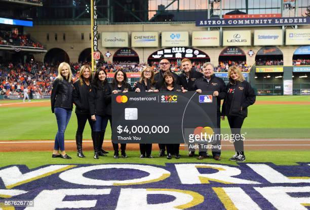 SU2C founders are presented witha $4 million donation raised through the MasterCard 'Priceless Causes' campaign before Game 4 of the 2017 World...