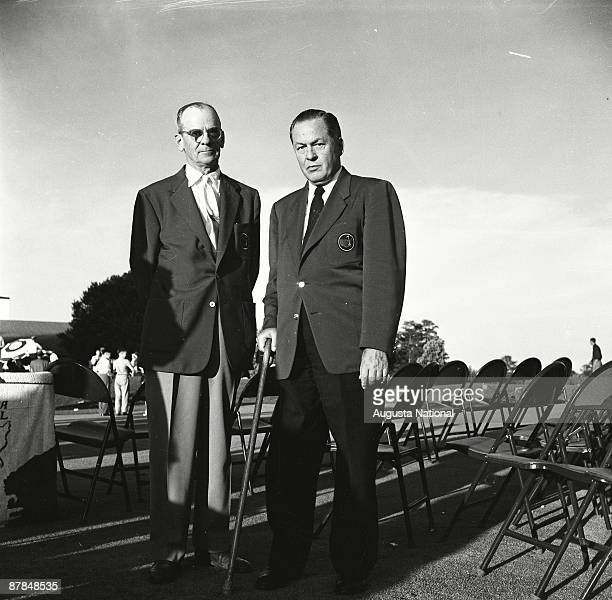 Founders Clifford Roberts and Bobby Jones wait at the Presentation Ceremony during the 1954 Masters Tournament at Augusta National Golf Club in April...