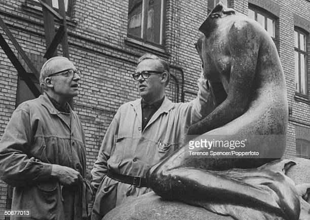 Foundry owner Poul L Rasmussen with his son Haus who will be reapiring Copenhagen's Famous `Little Mermaid' Statue whose head was sawed off and...