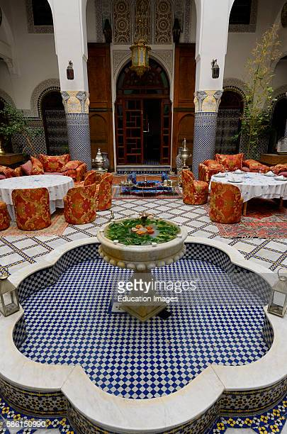 Fountain and dining area in Moorish style at Riad El Yacout in Fes el Bali Morocco