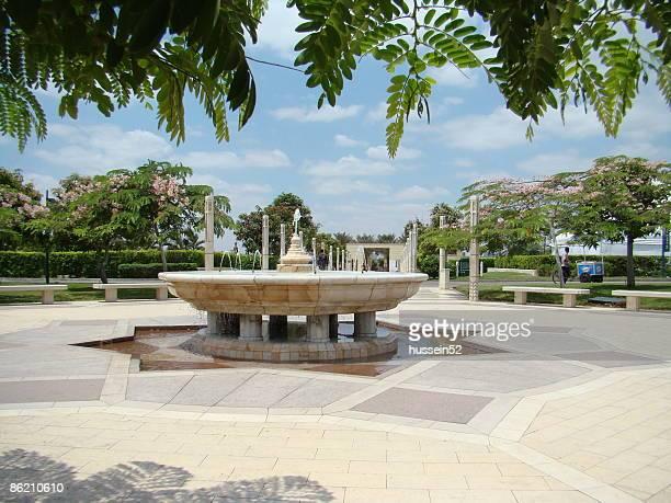 Fountain blue sky green tree, Azhar park
