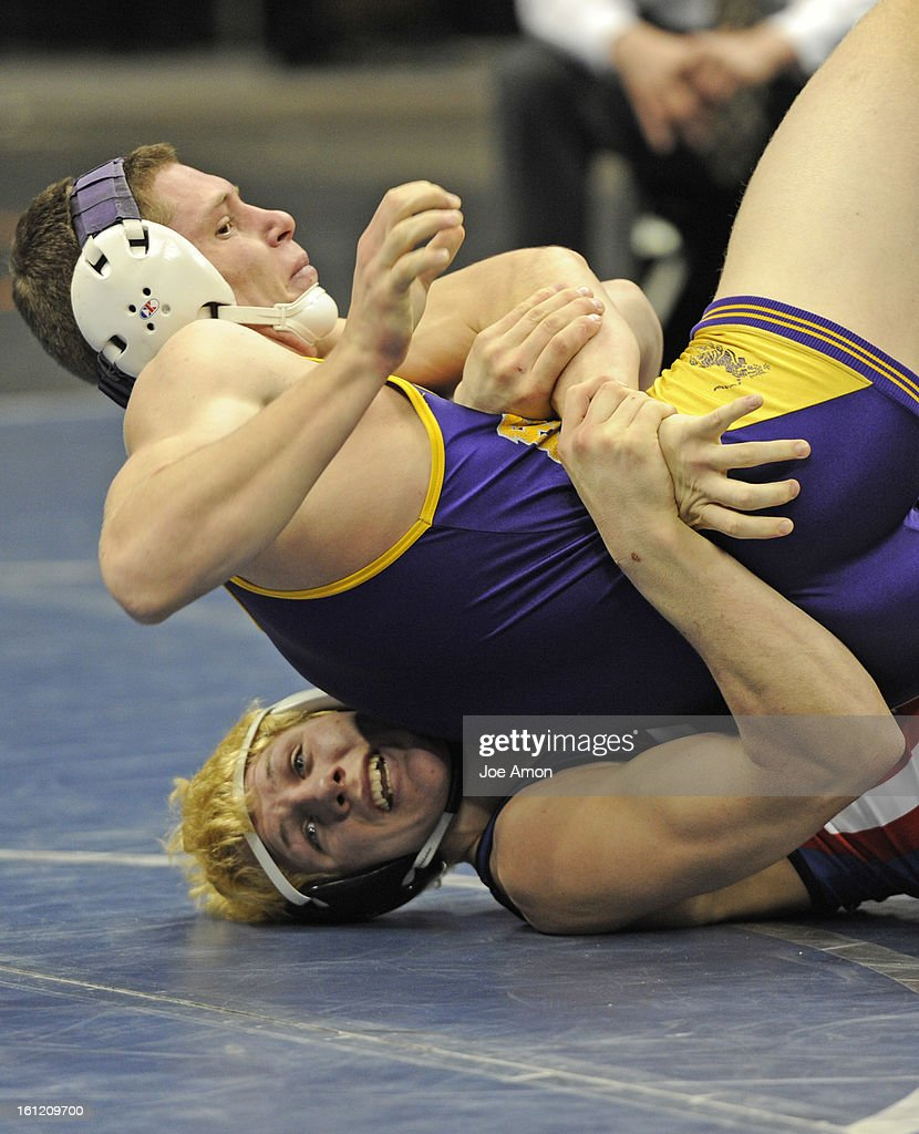 fountain fort carson s josh schoenberger bottom defeats fountain fort carson s josh schoenberger bottom defeats boulder s axel wessell in 182lb class 5a state championship round wrestling action saturday