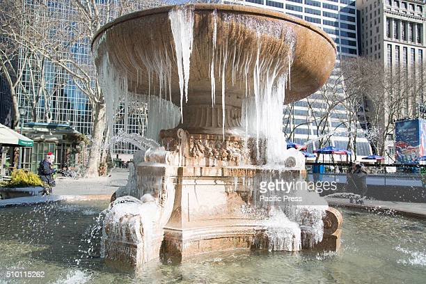 A fountain fozen over in Bryant Park Midtown Manhattan Mayor De Blasio tells New Yorkers to stay indoors as temperatures continue to drop and New...
