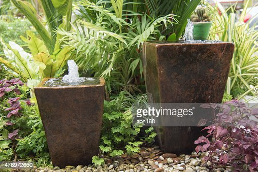 fountain from pot : Stock Photo