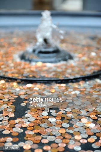 Fountain full of coins : Stock Photo