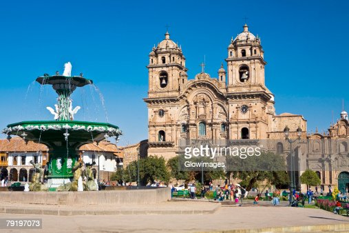 Fountain in front of a church, La Compania, Plaza-De-Armas, Cuzco, Peru