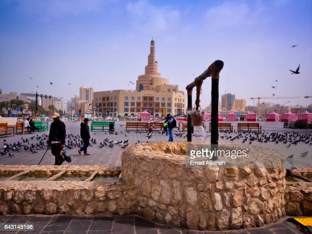 Fountain in the shape of water well at souq waqif opposite the Spiral Mosque, Doha, Qatar - April 03, 2017