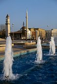 Fountain on Skanderbeg square with the Et'hem Bey Mosque and clock tower in the background Tirana Albania